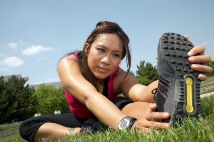 Athletic woman stretches before a run